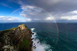 stunning-rainbow-links-the-indian-and-atlantic-oceans-south-africa-photo-by-chris-mclennan1